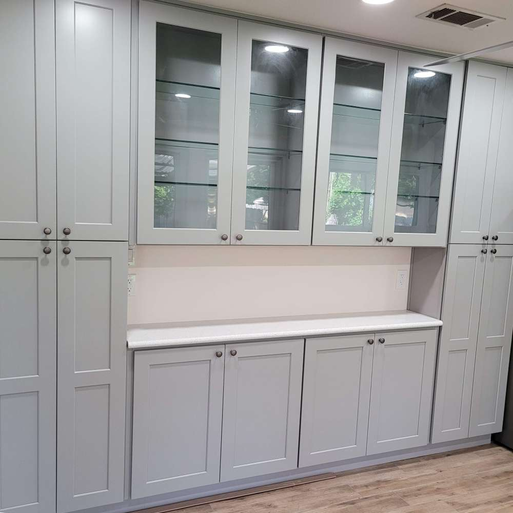 Clean Gray shaker style cabinets with clear glass doors uppers