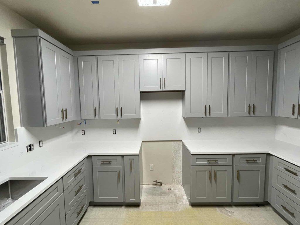 Modern Grey Shaker Cabinet Kitchen with white quartz countertop