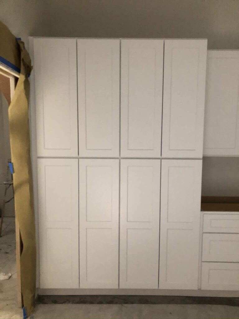 Modern Unfinished White Shaker Cabinet Kitchen with no countertop